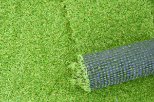 Artificial green grass laying background for your design