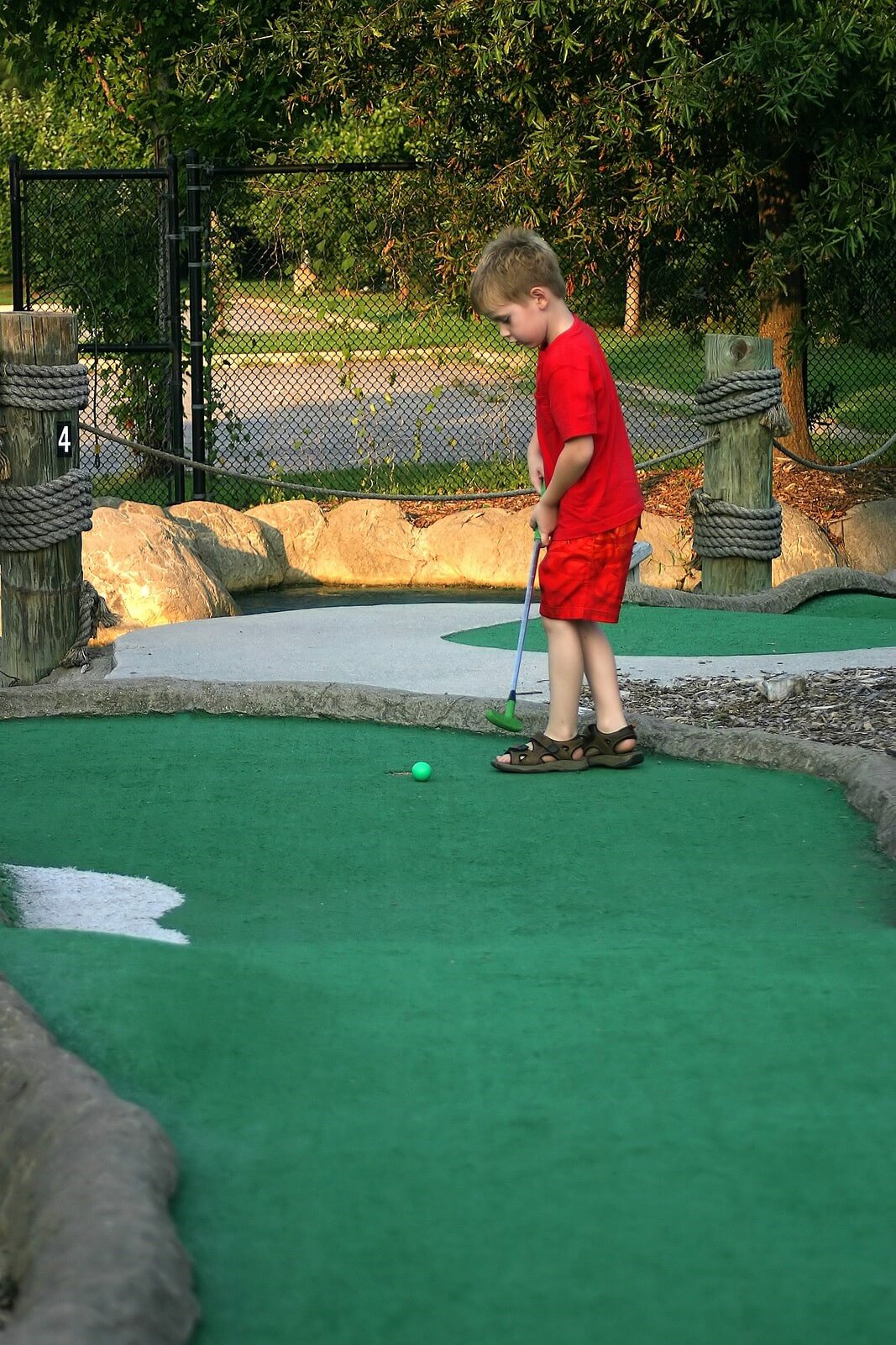kid in artificial golf grass
